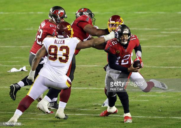 Quarterback Tom Brady of the Tampa Bay Buccaneers is chased and eventually sacked by defensive tackle Jonathan Allen and defensive end Montez Sweat...