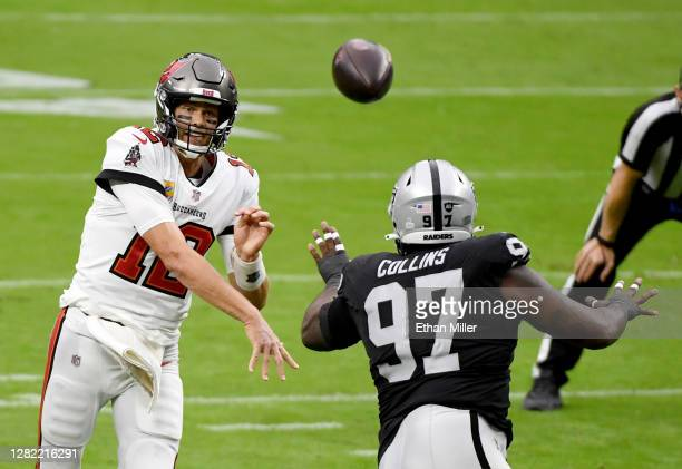 Quarterback Tom Brady of the Tampa Bay Buccaneers throws under pressure from defensive tackle Maliek Collins of the Las Vegas Raiders during the...