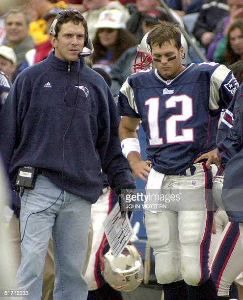 Quarterback Tom Brady stands on the sidelines with injured Quarterback Drew Bledsoe of the New England Patriots during the first quarter of action...