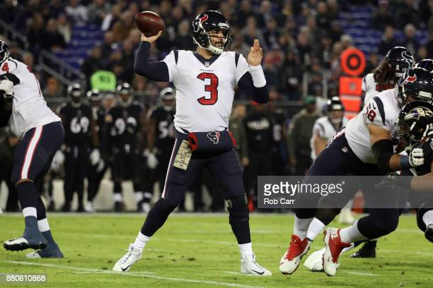 Quarterback Tom Savage of the Houston Texans throws in the first quarter against the Baltimore Ravens at MT Bank Stadium on November 27 2017 in...