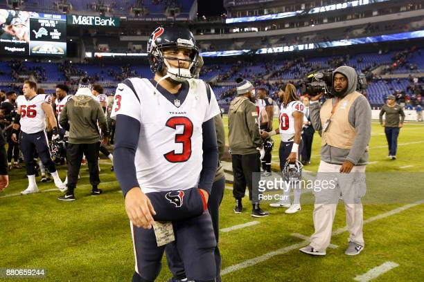 Quarterback Tom Savage of the Houston Texans walks off the field after a 1623 loss to the Baltimore Ravens at MT Bank Stadium on November 27 2017 in...