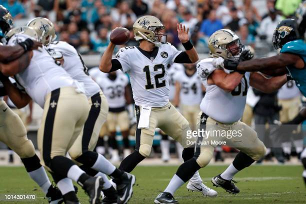 Quarterback Tom Savage of the New Orleans Saints on a pass play during a preseason game against the Jacksonville Jaguars at TIAA Bank Field on August...