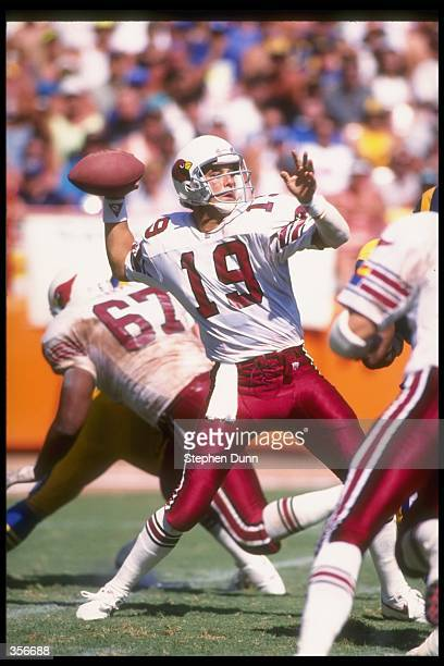 Quarterback Tom Tupa of the Phoenix Cardinals prepares to throw the ball during a game against the Los Angeles Rams at Sun Devil Stadium in Tempe...