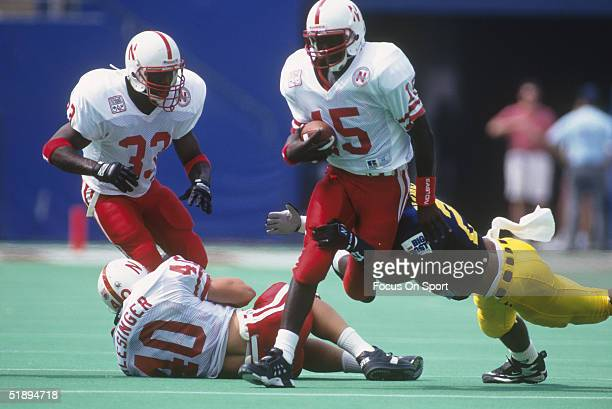 Quarterback Tommie Frazier of the University of Nebraska Cornhuskers runs through the West Virginia Mountaineers defense in 1994