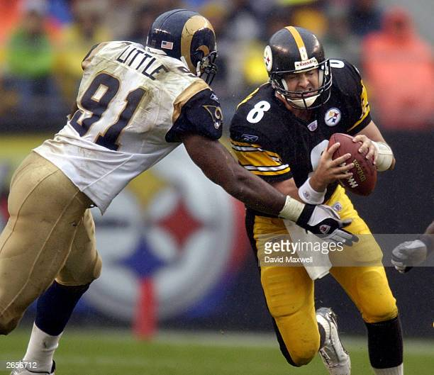Quarterback Tommy Maddox of the Pittsburgh Steelers about to be sacked by Leonard Little of the St. Louis Rams during the second quarter on October...