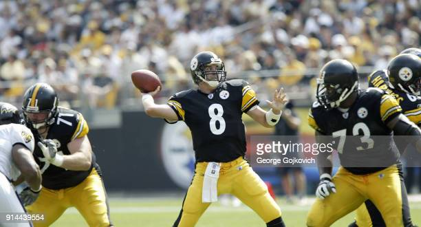 Quarterback Tommy Maddox of the Pittsburgh Steelers passes as offensive linemen Todd Fordham and Kendall Simmons block during a game against the...