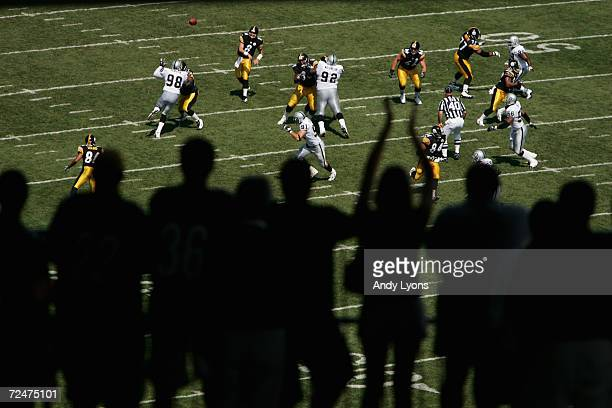 Quarterback Tommy Maddox of the Pittsburgh Steelers throws a pass as fans cheer during the game against the Oakland Raiders at Heinz Field on...