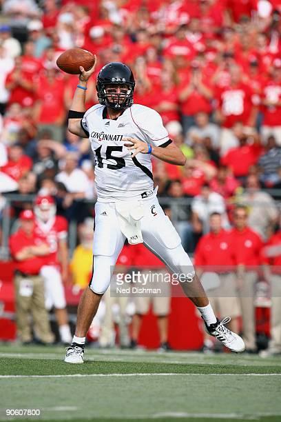 Quarterback Tony Pike of the University of Cincinnati Bearcats passes against the Rutgers University Scarlett Knights on September 7, 2009 at Rutgers...