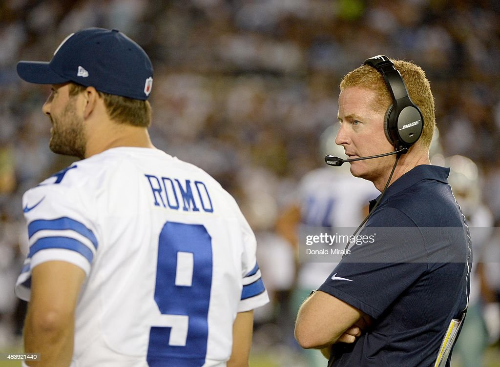 Quarterback Tony Romo #9 and Head Coach Jason Garrett of The Dallas Cowboys looks on from the sidelines against the San Diego Chargers during their NFL Preseason game at Qualcomm Stadium on August 13, 2015 in San Diego, California.