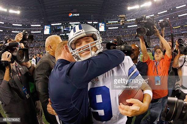 Quarterback Tony Romo of the Dallas Cowboys celebrates with head coach Jason Garrett of the Dallas Cowboys after the Cowboys beat the Detroit Lions...