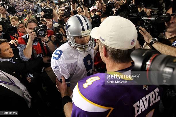 Quarterback Tony Romo of the Dallas Cowboys congratulates quarterback Brett Favre of the Minnesota Vikings on their 34-3 victory during the NFC...
