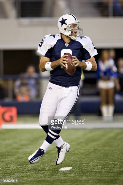 Quarterback Tony Romo of the Dallas Cowboys drops back to make a pass during a game against the Oakland Raiders at Cowboys Stadium on November 26,...