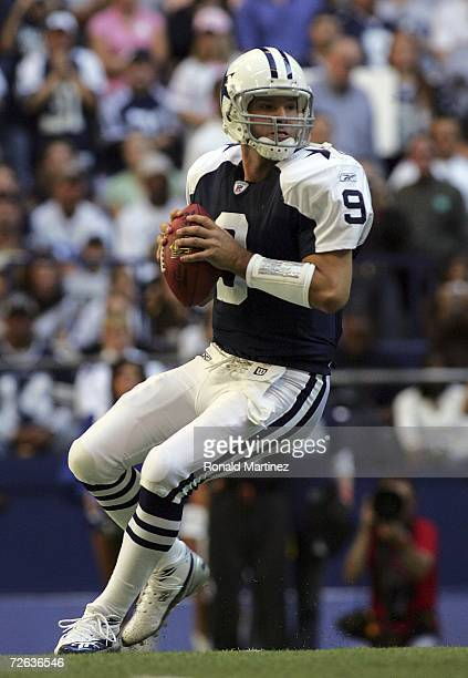Quarterback Tony Romo of the Dallas Cowboys drops back to pass against the Tampa Bay Buccaneers at Texas Stadium November 23 2006 in Irving Texas