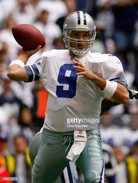 Quarterback Tony Romo of the Dallas Cowboys drops back to pass against the New York Giants during the NFC Divisional Playoff game at Texas Stadium on...
