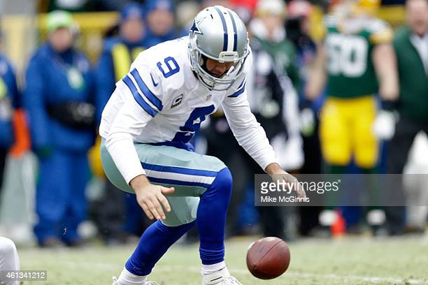 Quarterback Tony Romo of the Dallas Cowboys fumbles the football in the first quarter of the 2015 NFC Divisional Playoff game against the Green Bay...