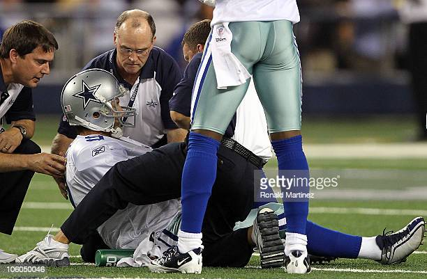 Quarterback Tony Romo of the Dallas Cowboys lies on the field after a left shoulder injury in the second quarter against the New York Giants at...