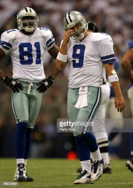 Quarterback Tony Romo of the Dallas Cowboys reacts after an intentional grounding penalty during the fourth quarter of the NFC Divisional Playoff...