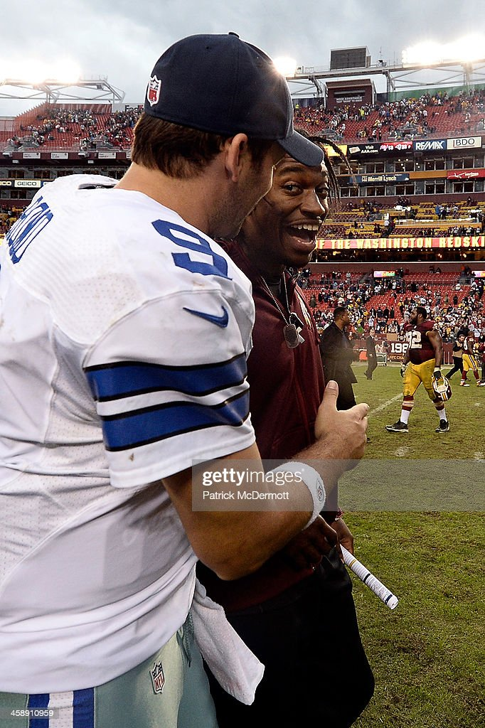 Quarterback Tony Romo #9 of the Dallas Cowboys shakes hands with quarterback Robert Griffin III #10 of the Washington Redskins after the Cowboys defeated the Redskins 24-23 during an NFL game at FedExField on December 22, 2013 in Landover, Maryland.
