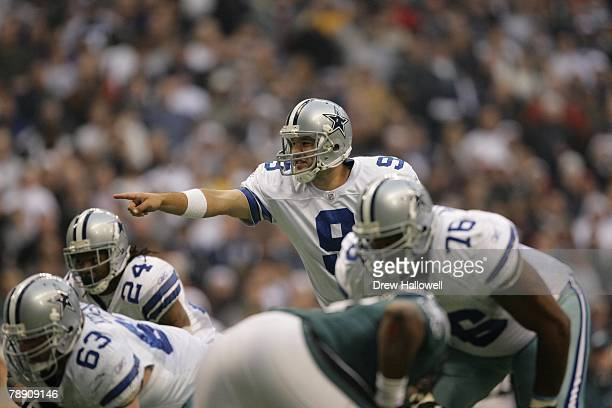Quarterback Tony Romo of the Dallas Cowboys signals during the game against the Philadelphia Eagles on December 16 2007 at Texas Stadium in Irving...