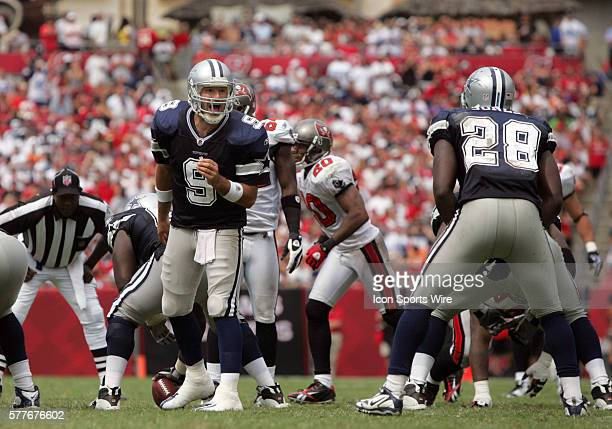 Quarterback Tony Romo of the Dallas Cowboys signals the play change during the game between the Dallas Cowboys and the Tampa Bay Buccaneers at...