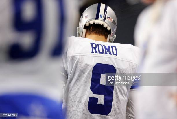 Quarterback Tony Romo of the Dallas Cowboys stands dejected after fumbling the field goal snap in the fourth quarter of the NFC Wild Card Playoff...