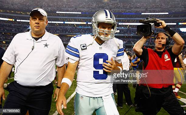 Quarterback Tony Romo of the Dallas Cowboys walks off the field after the Washington Redskins beat the Cowboys 2017 in overtime at Cowboys Stadium on...