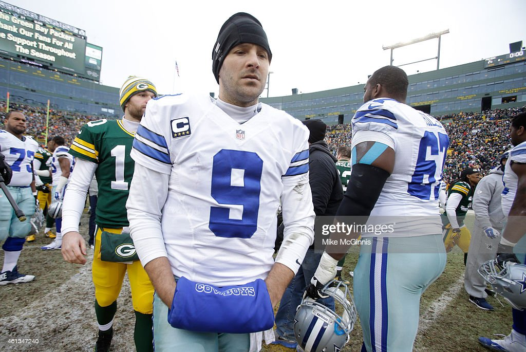 Quarterback Tony Romo #9 of the Dallas Cowboys walks off the field after the Green Bay Packers won 26-21 during the 2015 NFC Divisional Playoff game at Lambeau Field on January 11, 2015 in Green Bay, Wisconsin.