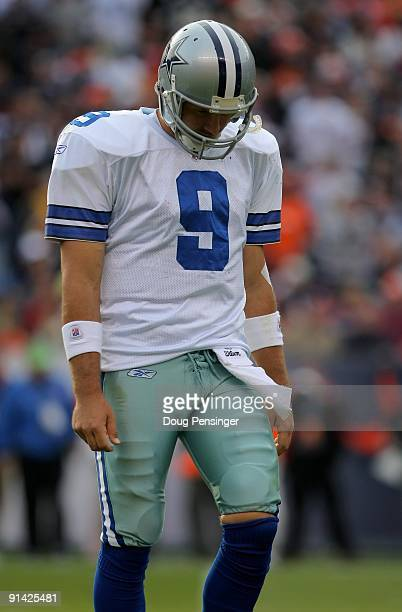 Quarterback Tony Romo of the Dallas Cowboys walks to the bench after failing to convert a third down against the Denver Broncos during NFL action at...