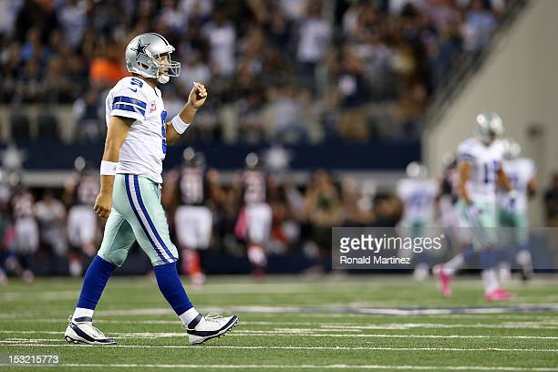 Quarterback Tony Romo of the Dallas Cowboys walks towards the sideline after he threw an interception which Lance Briggs of the Chicago Bears...
