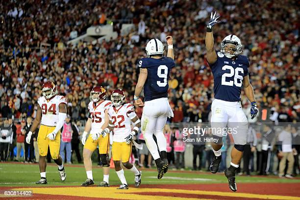 Quarterback Trace McSorley of the Penn State Nittany Lions celebrates with running back Saquon Barkley after rushing for a 3yard touchdown in the...