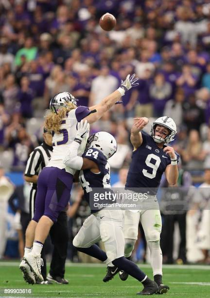 Quarterback Trace McSorley of the Penn State Nittany Lions throws a deep pass under pressure from linebacker Ben BurrKirven of the Washington Huskies...