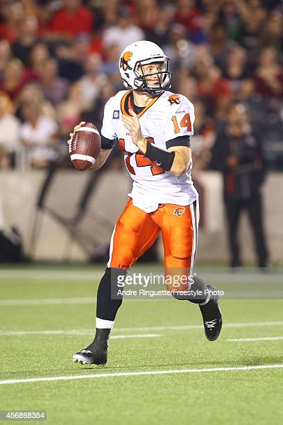 Quarterback Travis Lulay of the BC Lions passes the ball against the Ottawa Redblacks during a CFL game at TD Place Stadium on October 8 2014 in...