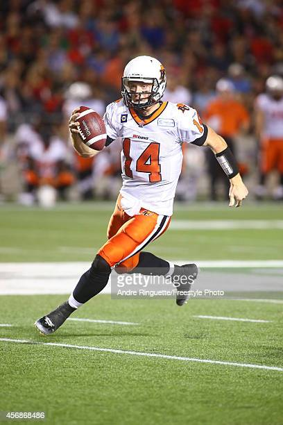 Quarterback Travis Lulay of the BC Lions rushes against the Ottawa Redblacks during a CFL game at TD Place Stadium on October 8 2014 in Ottawa...