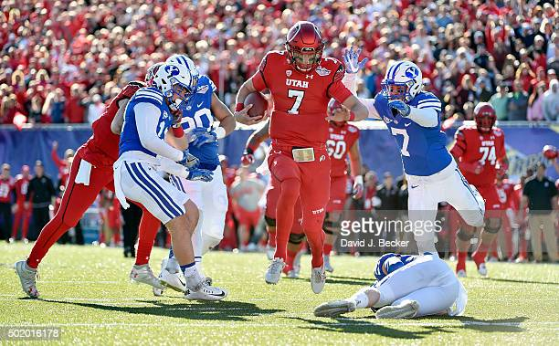 Quarterback Travis Wilson of the Utah Utes runs with the ball for a touchdown against the Brigham Young Cougars during the Royal Purple Las Vegas...