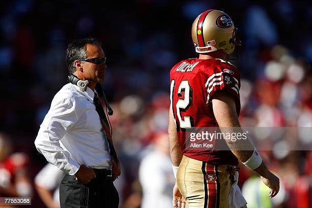 Quarterback Trent Dilfer of the San Francisco 49ers walks past head coach Mike Nolan during the game against the Baltimore Ravens at Monster Park on...