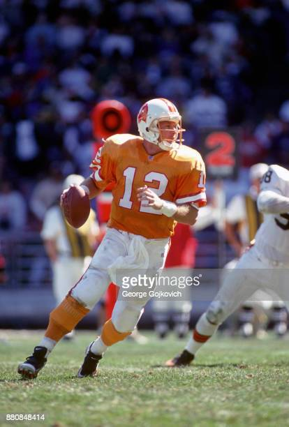 Quarterback Trent Dilfer of the Tampa Bay Buccaneers looks to pass during a game against the Cleveland Browns at Cleveland Municipal Stadium on...