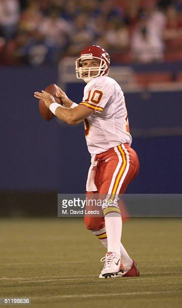 Quarterback Trent Green of the Kansas City Chiefs drops back to pass against the New York Giants during the preseason game at Giants Stadium on...