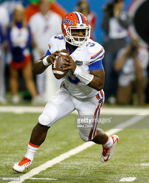 Quarterback Treon Harris of the Florida Gators rolls out during the SEC Championship game against the Alabama Crimson Tide at Georgia Dome on...