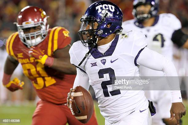 Quarterback Trevone Boykin of the TCU Horned Frogs scrambles for yards as defensive lineman Pierre Aka of the Iowa State Cyclones in the second half...