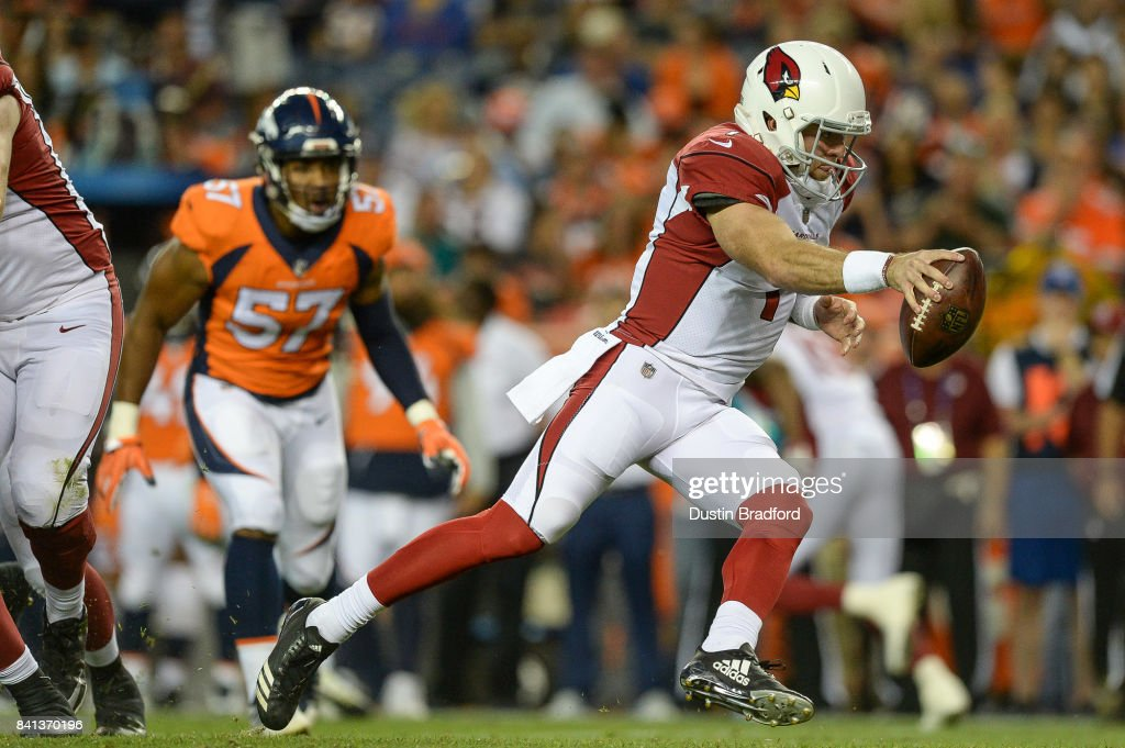 Quarterback Trevor Knight #1 of the Arizona Cardinals fakes a handoff against the Denver Broncos in the second quarter during a preseason NFL game at Sports Authority Field at Mile High on August 31, 2017 in Denver, Colorado.