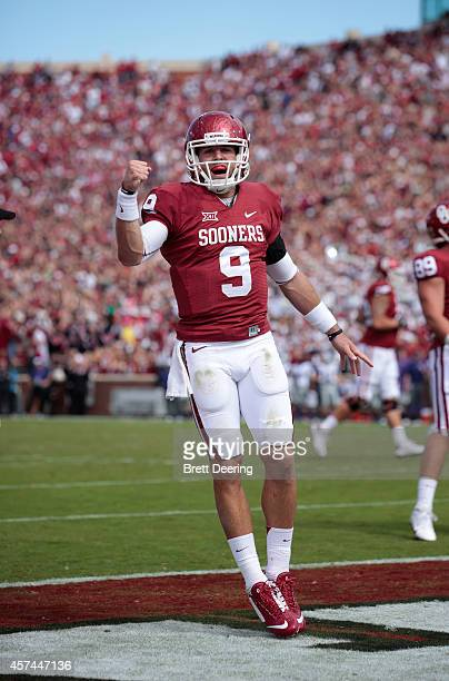 Quarterback Trevor Knight of the Oklahoma Sooners celebrates a touchdown against the Kansas State Wildcats October 18, 2014 at Gaylord...