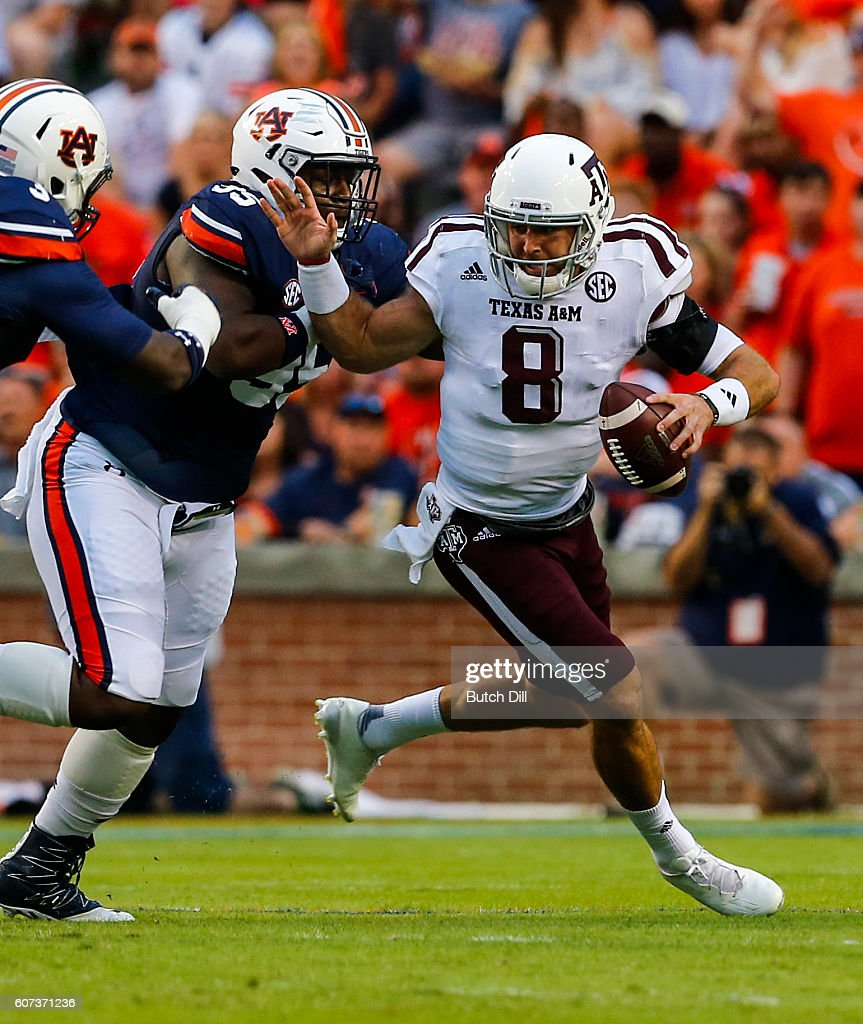 Quarterback Trevor Knight #8 of the Texas A&M Aggies is sacked by defensive lineman Dontavius Russell #95 of the Auburn Tigers during an NCAA college football game on September 17, 2016 in Auburn, Alabama.