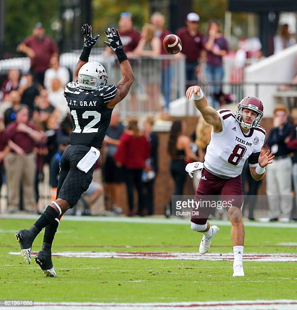 Quarterback Trevor Knight of the Texas AM Aggies throws a pass as linebacker JT Gray of the Mississippi State Bulldogs tries to block it during the...