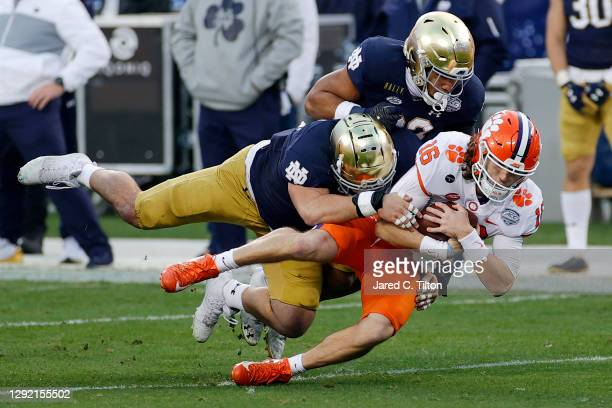 Quarterback Trevor Lawrence of the Clemson Tigers is tackled in the first half by the Notre Dame Fighting Irish during the ACC Championship game at...