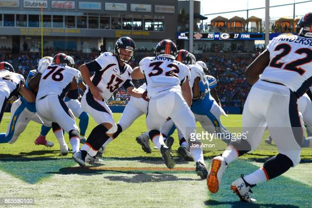 Quarterback Trevor Siemian hands off to fullback Andy Janovich of the Denver Broncos in the end zone as the Denver Broncos take on the Los Angeles...