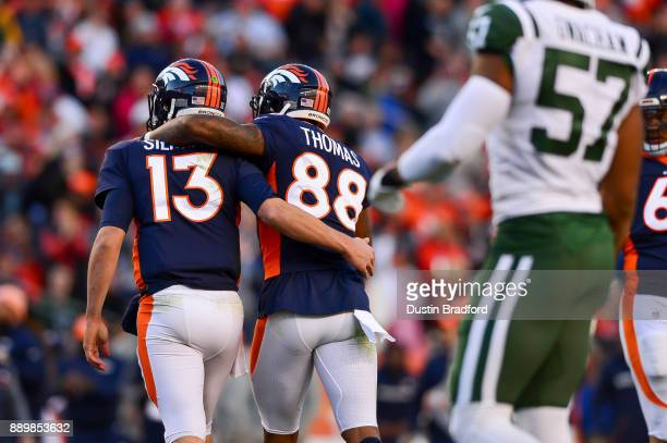 Quarterback Trevor Siemian of the Denver Broncos and Demaryius Thomas celebrate after a third quarter touchdown by Andy Janovich against the New York...