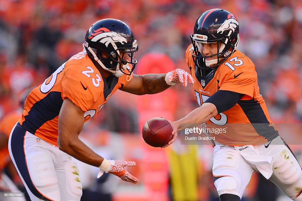 Quarterback Trevor Siemian #13 of the Denver Broncos hands the ball off to running back Devontae Booker #23 of the Denver Broncos at Sports Authority Field at Mile High on September 18, 2016 in Denver, Colorado.