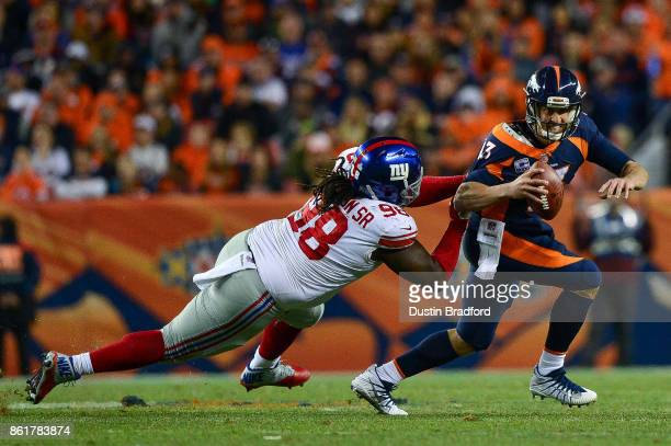 Quarterback Trevor Siemian of the Denver Broncos is sacked by defensive tackle Damon Harrison of the New York Giants in the third quarter of a game...