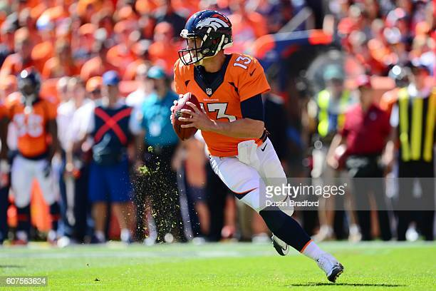 Quarterback Trevor Siemian of the Denver Broncos rolls out and throws a completion in the first quarter of the game against the Indianapolis Colts at...