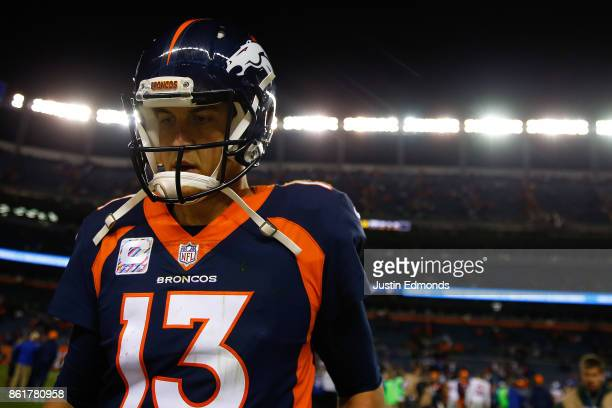 Quarterback Trevor Siemian of the Denver Broncos runs off the field after a loss to the New York Giants at Sports Authority Field at Mile High on...